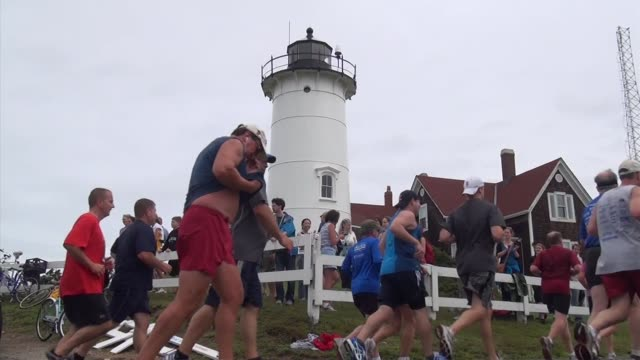 road racing the great american road race an annual event on cape cod along martha's vineyard sound runners past nobska lighthouse - salmini stock videos & royalty-free footage