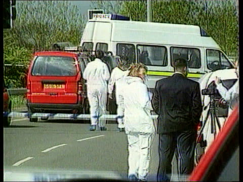 road rage murder kenneth noye extradition lib police at scene of murder of cameron on m25 slip road van cameron was driving police vehicles at scene - kenneth noye stock videos & royalty-free footage