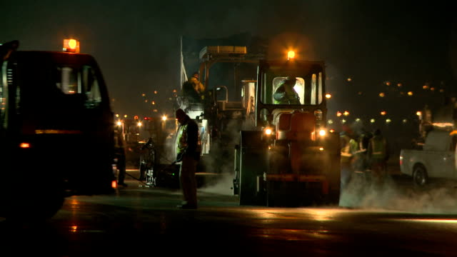 ws pan road resurfacing machines on a construction site at night, cape town, south africa - construction worker stock videos & royalty-free footage