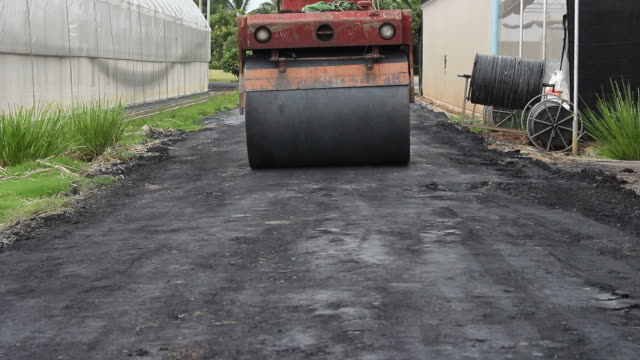 road rollers during asphalt paving works - steamroller stock videos and b-roll footage