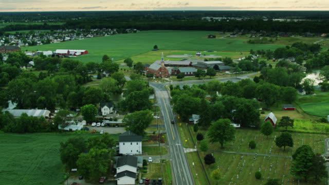 road running past graveyard in newport, michigan - aerial - michigan stock videos & royalty-free footage