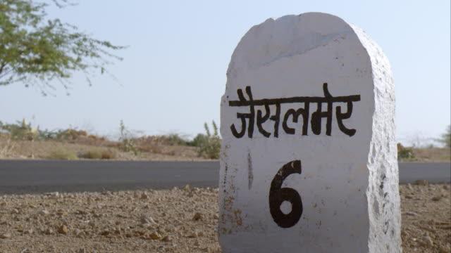 Road shot with milestone of Jaisalmer