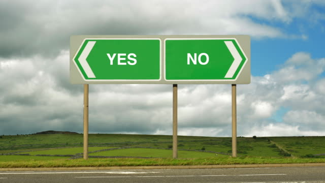 Road sign at a junction to decide Yes or No
