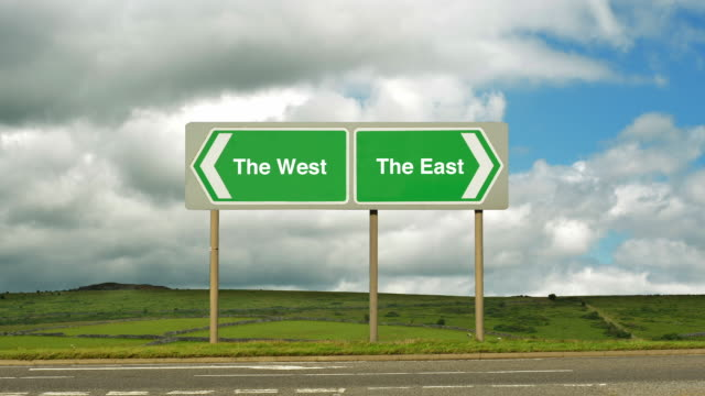 Road sign at a junction to The West or to The East