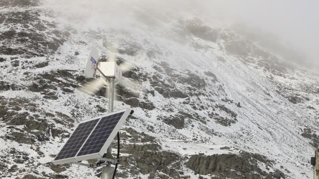 a road sign being powered by both solar and wind power on kirkstone pass in the lake district in winter conditions - winter sport stock videos & royalty-free footage
