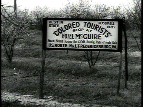 Road sign Colored Tourists stop at Hotel McGuire / Fredericksburg Virginia USA
