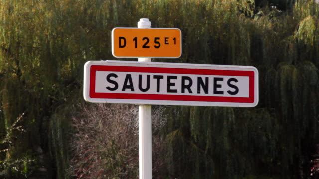 vidéos et rushes de cu road sign for sauternes / aquitaine, france - aquitaine