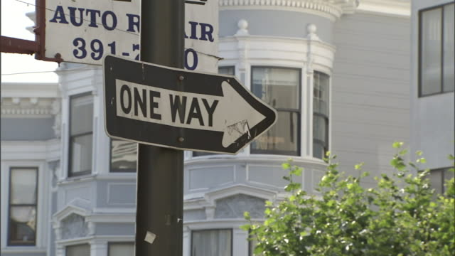 a road sign identifies a one-way street. - road sign stock videos & royalty-free footage