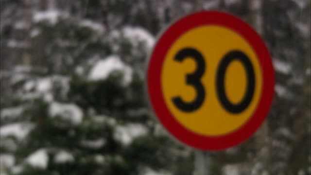 vidéos et rushes de a road sign in the winter sweden. - sign