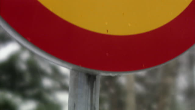 a road sign in the winter sweden. - speed limit sign stock videos & royalty-free footage