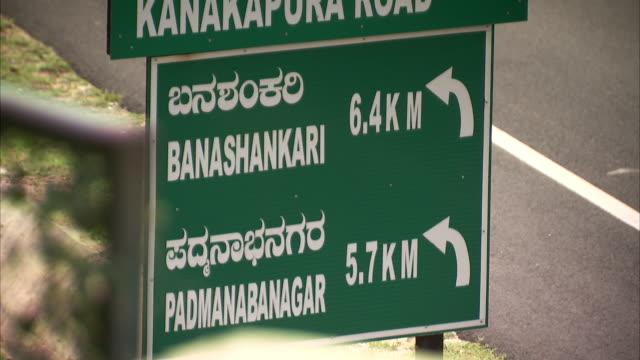 a road sign near bangalore. - kilometre stock videos & royalty-free footage