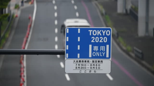 road sign of priority lane for 2020 olympics related vehicles in ariake area, in tokyo, japan, on monday, july 26, 2021. - focus on foreground stock videos & royalty-free footage