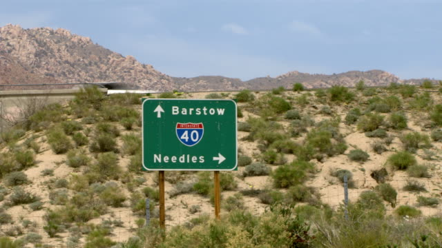 A road sign points the way to Barstow and Needles.