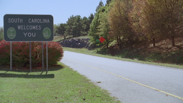 road sign - south carolina welcomes you - south carolina stock videos & royalty-free footage