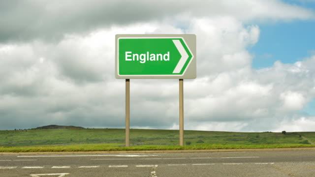 road sign to england - gruppo medio di animali video stock e b–roll