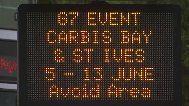 road sign warning of delays around the st ives and carbis bay area of cornwall due to the g7 summit - road sign stock videos & royalty-free footage