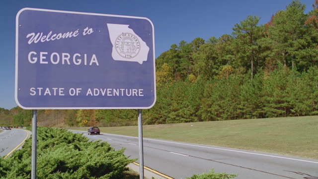 road sign - welcome to georgia - road sign stock videos & royalty-free footage