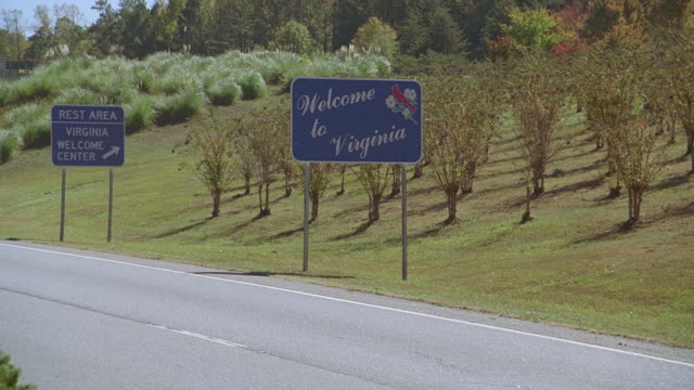 road sign - welcome to virginia - western script stock videos & royalty-free footage