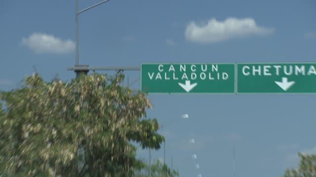 vídeos y material grabado en eventos de stock de pov road signs in the yucatan peninsula, mexico - quintana roo