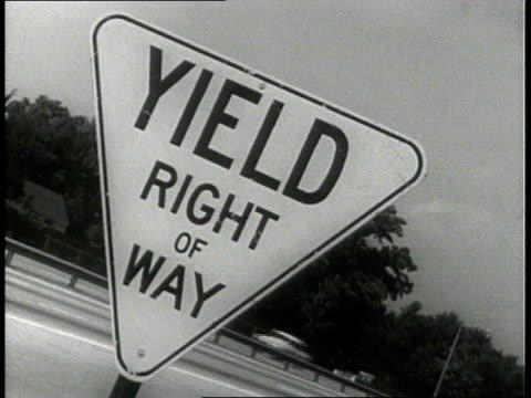 1963 montage road signs on highway / united states - speed limit sign stock videos & royalty-free footage