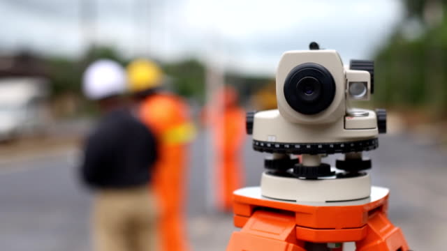 road survey engineer and surveyor's telescope at new road construction site - surveyor stock videos and b-roll footage