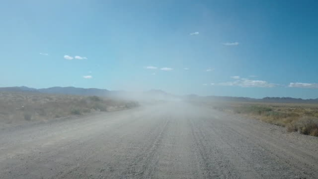 road that leads before the start of a 'storm area 51' spinoff event called 'area 51 basecamp' on september 20, 2019 near alamo, nevada. the event is... - nevada stock-videos und b-roll-filmmaterial