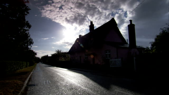 A road through Chelsworth village. Available in HD.