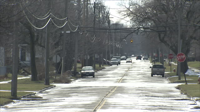road through residential area in midwest town - run down stock videos & royalty-free footage