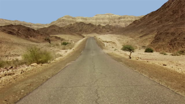road through the desert - clear sky stock videos & royalty-free footage