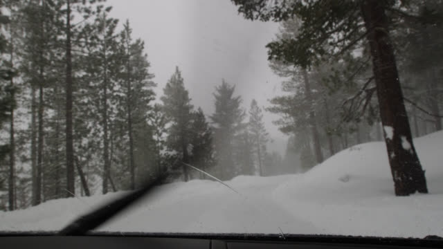 WS POV Road through the snow in Lassen Volcanic National Park near Red Bluff / Red Bluff, California, USA
