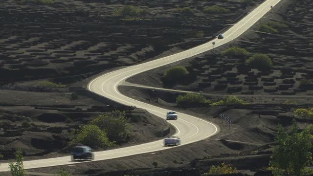 ws, ha road through volcanic landscape with vineyards, la geria, lanzarote, canary islands, spain - atlantikinseln stock-videos und b-roll-filmmaterial