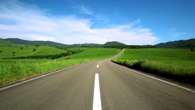 road to mountain. - horizon over land stock videos & royalty-free footage