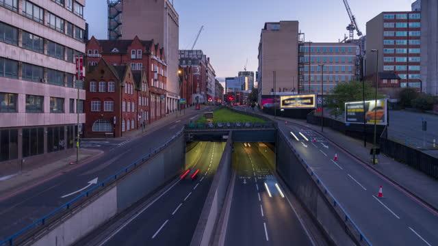 road traffic in birmingham city centre, west midlands, uk at dusk - 4k time-lapse (tilt-up) - west midlands stock videos & royalty-free footage