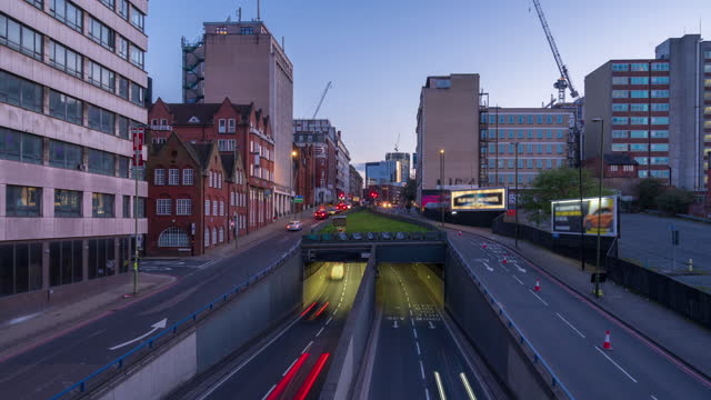 road traffic in birmingham city centre, west midlands, uk at dusk - 4k time-lapse - west midlands stock videos & royalty-free footage