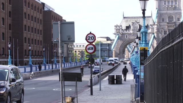 road traffic through the tower hill area of london the day after the prime minister announced his 'road map' to ease lockdown during the coronavirus... - road map stock videos & royalty-free footage