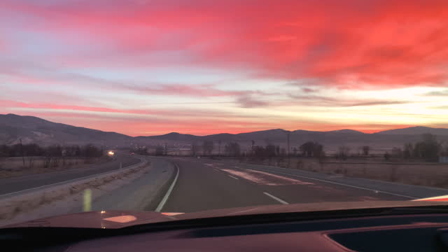 road trip at sunset, view from inside of the car - dashboard stock videos & royalty-free footage