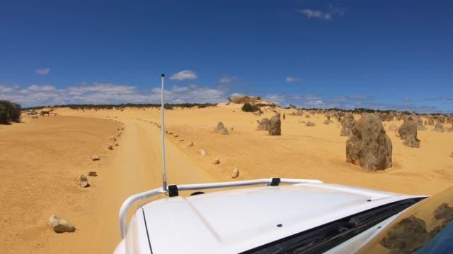 road trip drive in the pinnacles desert western australia - pinnacle stock videos & royalty-free footage
