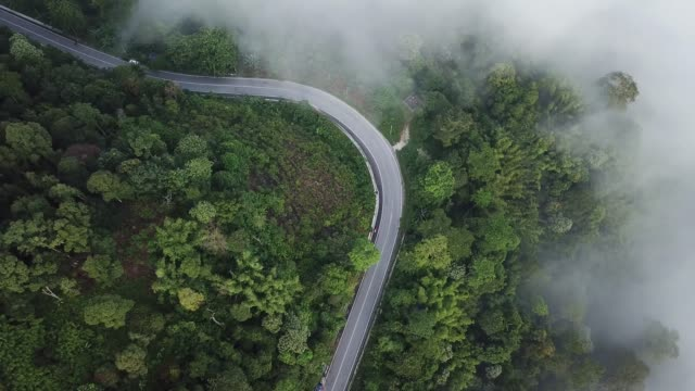 road trip drone point of view ulu langat morning with cloud mist with tropical forest mountain range - sustainable tourism stock videos & royalty-free footage