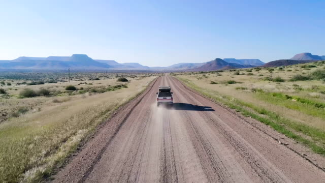 road trip in africa. aerial view - arid climate stock videos and b-roll footage