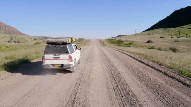 road trip in africa. aerial view - off road racing stock videos & royalty-free footage
