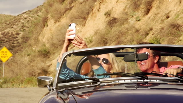 road trip mature road end - old convertible stock videos & royalty-free footage
