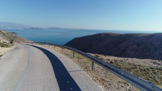 road trip o island krk - coastal road stock videos & royalty-free footage