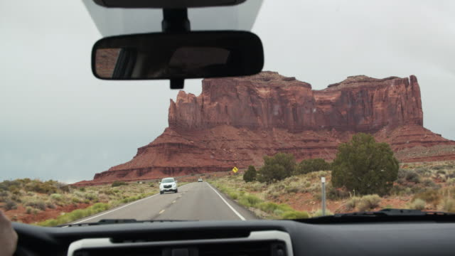 pov road trip through monument valley, utah - navajo culture stock videos & royalty-free footage