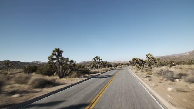 road trip through the desert. - joshua tree national park stock videos & royalty-free footage