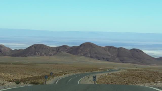 road while driving in atacama desert - san pedro de atacama stock videos & royalty-free footage