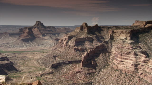a road winds through a canyon in the utah desert. available in hd - shrubland stock videos & royalty-free footage