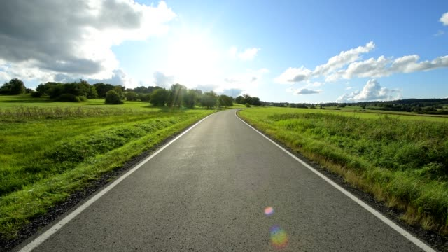 road with sun, oberelsbach, lange rhön, rhön mountain range, bavaria, germany - empty road stock videos and b-roll footage