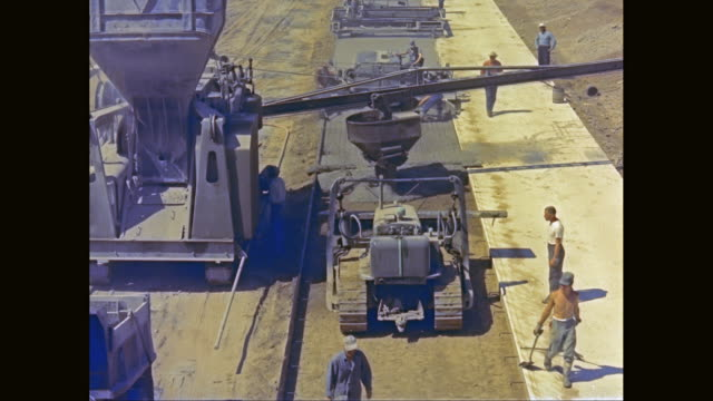 WS HA Road workers making concrete road / United States