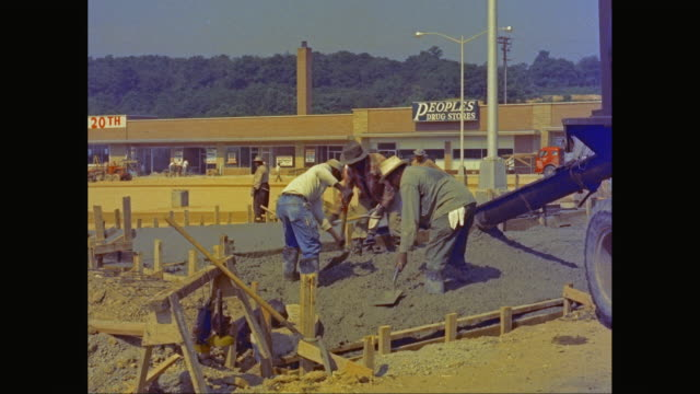 MS Road workers making concrete road / United States