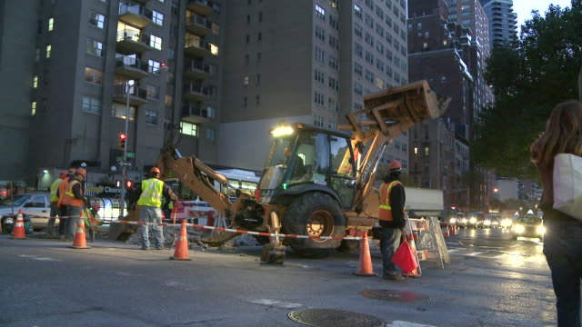 ms road works on 3rd avenue at dusk in manhattan / new york, new york, united states - road construction stock videos and b-roll footage
